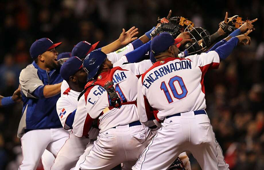 Edwin Encarnacion, Carlos Santana and other Dominican players celebrate their win over the Netherlands. Photo: Lance Iversen, The Chronicle