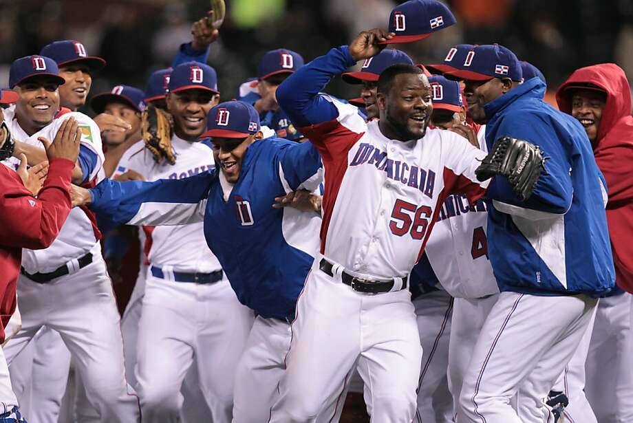 Dominican Republic's closing pitcher Fernando Rodney (56) with his teammates after defeating Netherlands 4-1 in a World Baseball Classic semi-final game in San Francisco on Monday, March 18, 2013. Photo: Mathew Sumner, Special To The Chronicle