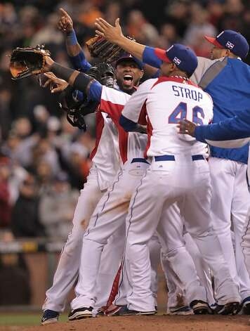 Dominican Republic's shortstop Jose Reyes celebrates with his teammates after defeating Netherlands 4-1 in a World Baseball Classic semi-final game in San Francisco on Monday, March 18, 2013. Photo: Mathew Sumner, Special To The Chronicle
