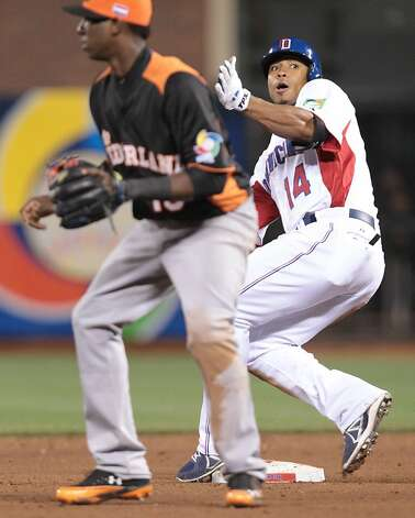 Dominican Republic's Moises Sierra comes into second base on an RBI double against the Netherlands while playing in a World Baseball Classic semi-final game in San Francisco on Monday, March 18, 2013. Photo: Mathew Sumner, Special To The Chronicle