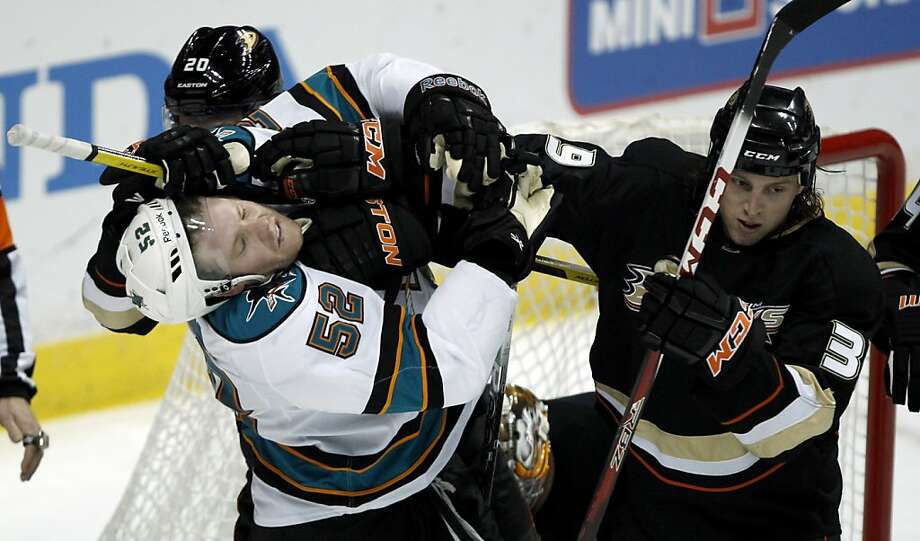 The Sharks' Matt Irwin (52) mixes it up with the Ducks' David Steckel and Matt Beleskey (right). Photo: Alex Gallardo, Associated Press