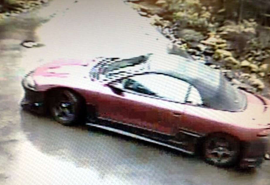 The woman and her accomplice left in this red convertible, investigators said. Photo: West, Cindi L