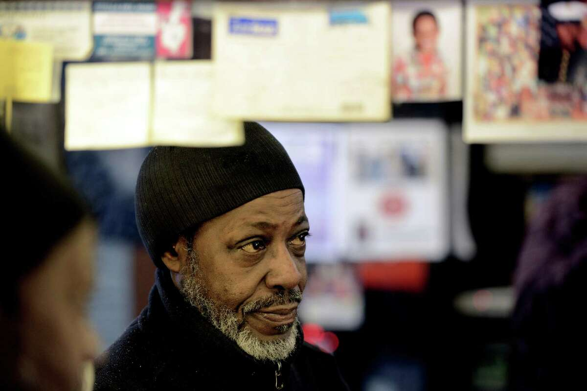 Willie Stancil Jr. is reflected in one of the mirrors of Stancil's Barbershop which was established in 1956 is still in full swing March 8, 2013, and may be one of the oldest barber shops on Albany, N.Y. (Skip Dickstein/Times Union)