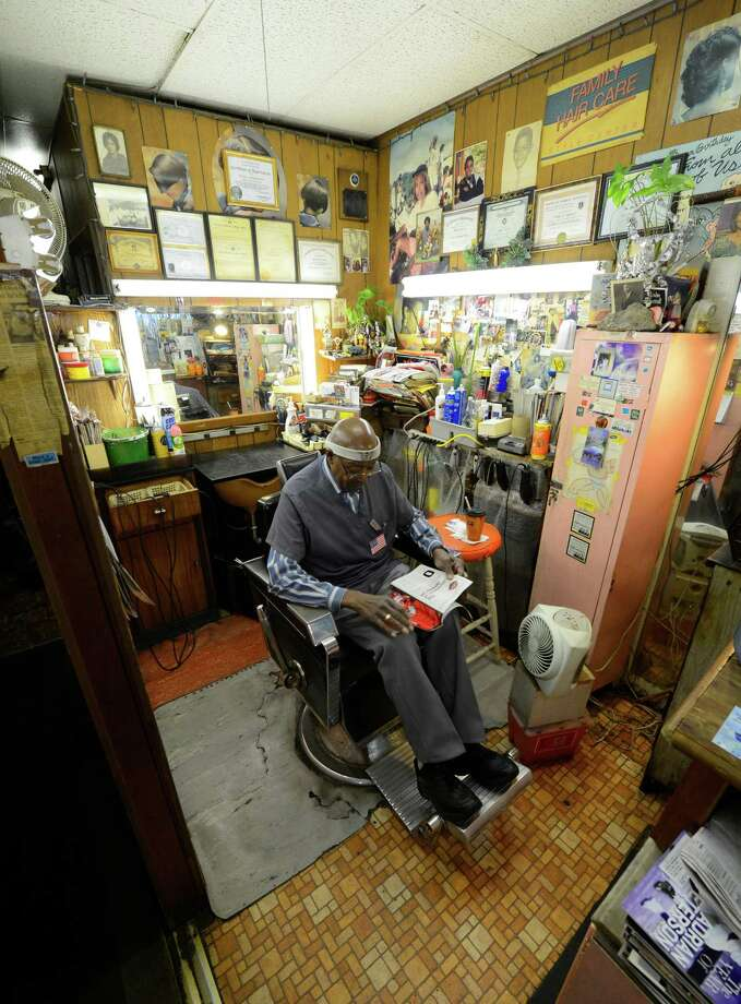 Willie Stancil Sr. relaxes between customers at Stancil's Barbershop which he established in 1956 and is still in full swing March 8, 2013, and may be one of the oldest barber shops on Albany, N.Y.  (Skip Dickstein/Times Union) Photo: SKIP DICKSTEIN / 10021482A