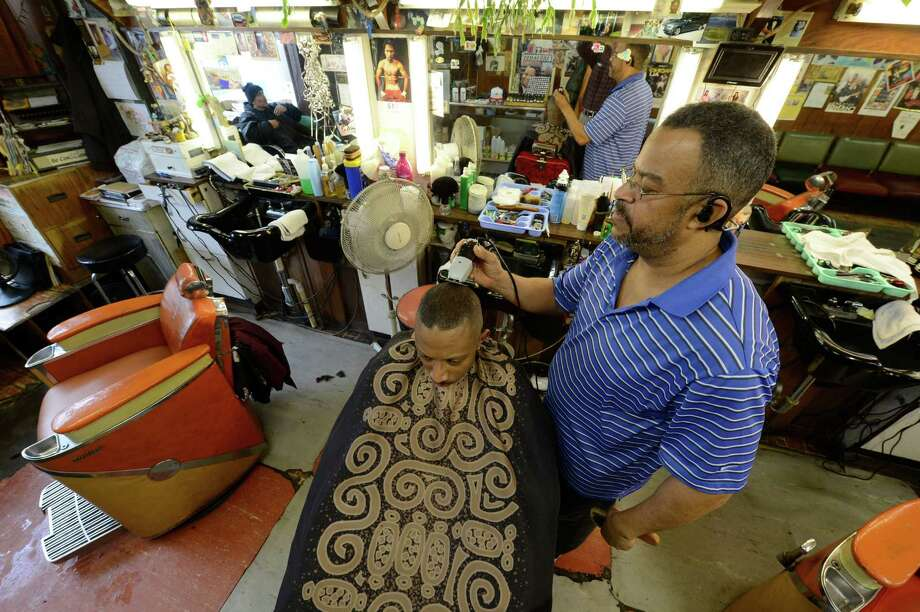 Barber Howard parker cuts Darrell McKnight's hair at Stancil's Barbershop which was established in 1956 is still in full swing March 8, 2013, and may be one of the oldest barber shops on Albany, N.Y.  (Skip Dickstein/Times Union) Photo: SKIP DICKSTEIN / 10021482A