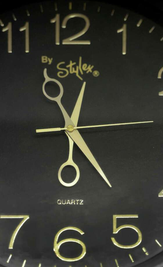 The clock on the wall at Stancil's Barbershop which was established in 1956 is still in full swing March 8, 2013, and may be one of the oldest barber shops on Albany, N.Y.  (Skip Dickstein/Times Union) Photo: SKIP DICKSTEIN / 10021482A