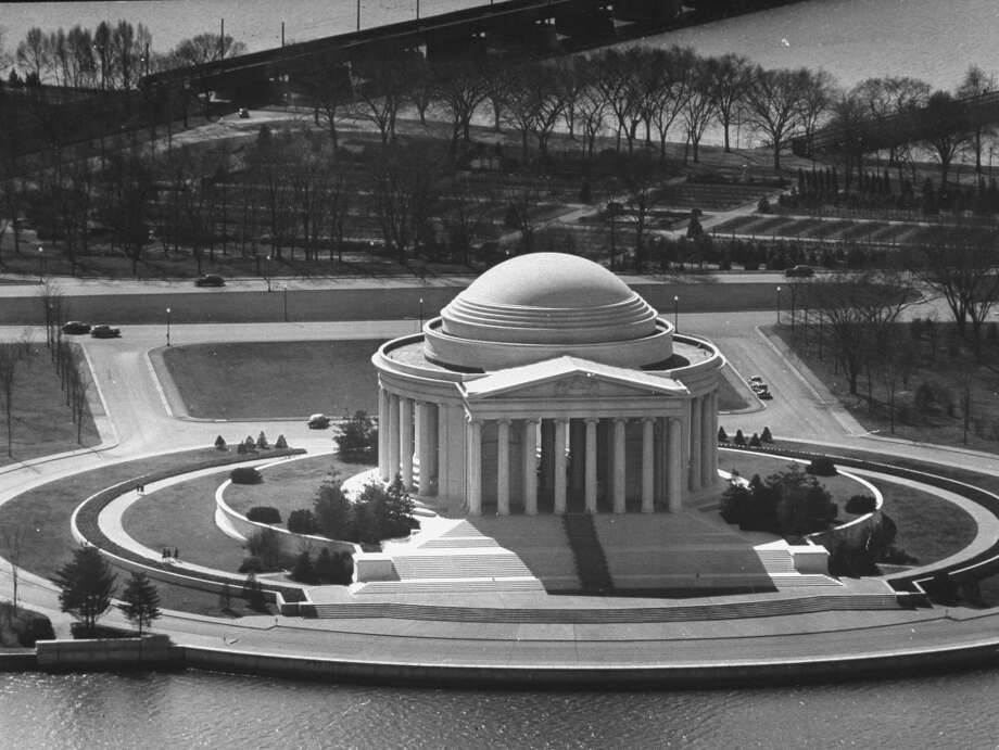 Congress approved construction of the Thomas Jefferson Memorial on the south bank of Washington's Tidal Basin in June 1934. Architect John Russell Pope used Thomas Jefferson's own architectural tastes to design the Jefferson Memorial, which is modeled after Rome's Pantheon.The location drew criticism because it displaced Japanese flowering cherry trees. The Commission of Fine Arts objected that the Pantheon design would compete with the Lincoln Memorial. President Franklin D. Roosevelt gave his permission to proceed and laid the cornerstone in 1939. Photo: George Skadding, Time & Life Pictures/Getty Image / Time Life Pictures