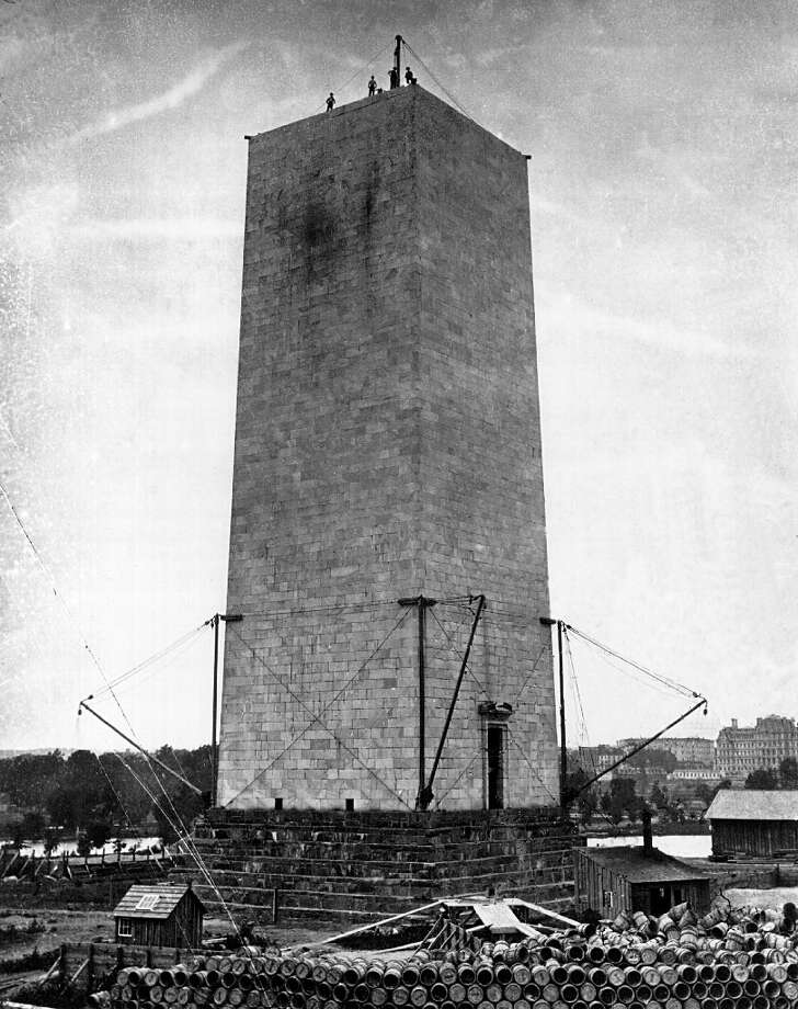 The Washington Monument had its own troubles. Construction stalled at 156 feet in 1854, after a new group aligned with the controversial Know-Nothing Party gained control of the Washington National Monument Society, driving away donors. Then, the Civil War broke out.Congress took over funding and construction of the monument in 1876. U.S. Army Corps of Engineers chief Lt. Col. Thomas Lincoln Casey cut the height from a planned 600 feet to 555 (10 times the width of the base) and scrapped plans for ornate adornments on the obelisk and the ring of columns around the base. Photo: National Archives, Getty Images / Getty Images North America