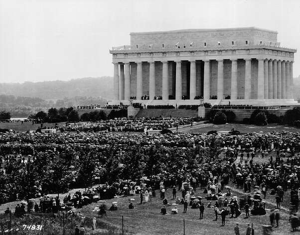 Architect Henry Bacon modeled the memorial after ancient Greek temples, calling for it to be 190 feet long, 119 feet wide and almost 100 feet high, surrounded by 36 fluted Doric columns, one for each of the thirty six states in the Union at the time of Lincoln's death. Similarly to the later National World War II memorial, some objected that the building was too ostentatious for a man of Lincoln's humble character, and proposed a simple log cabin shrine. The location also drew criticism, for being too swampy or inaccessible. This photo is from the memorial's dedication, in 1922. Photo: National Archives, Getty Images / Getty Images North America