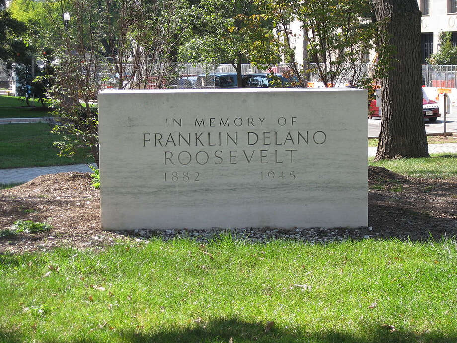 Speaking of Franklin D. Roosevelt, In 1941, he reportedly told friend Frankfurter, Supreme Court justice: If any memorial is erected to me, I know exactly what I should like it to be. I should like it to consist of a block about the size of this (desk) and placed in the center of that green plot in front of the Archives building. I don't care what it is made of, whether limestone, or granite or whatnot, but I want it plain without ornamentation, with the simple carving, 'In Memory Of.' A small group of living associates of the President did just that on April 12, 1965, the 20th of his death.