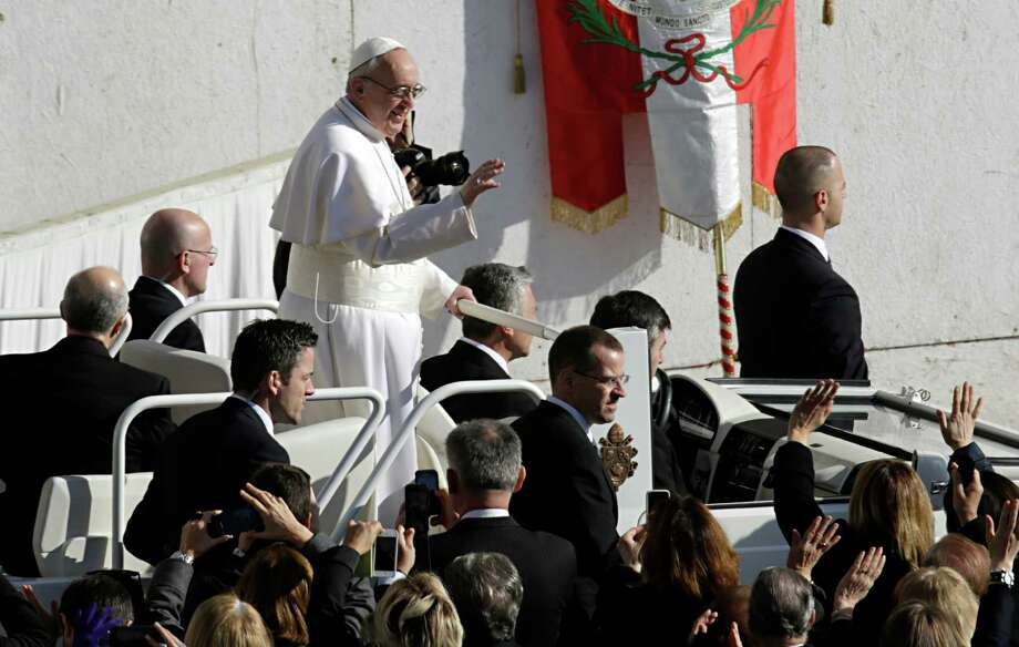 Pope Francis waves upon his arrival in St. Peter's Square for his inaugural Mass, at the Vatican, Tuesday, March 19, 2013. Photo: Andrew Medichini