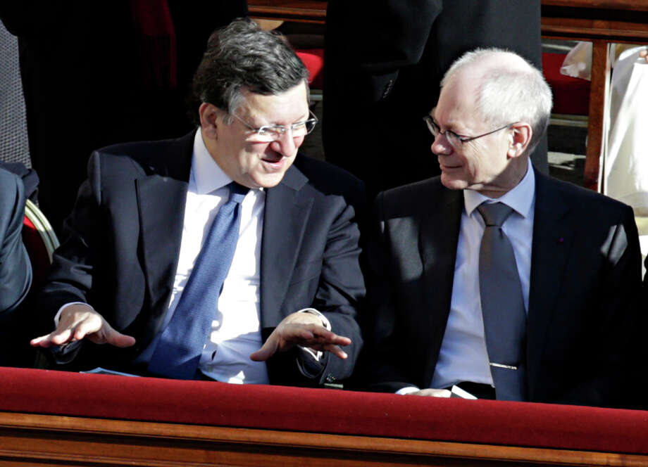 European Commission President Jose Manuel Barroso, left, and European Council President Herman Van Rompuy take their seats for the inaugural Mass of Pope Francis, at the Vatican, Tuesday, March 19, 2013. Photo: Andrew Medichini