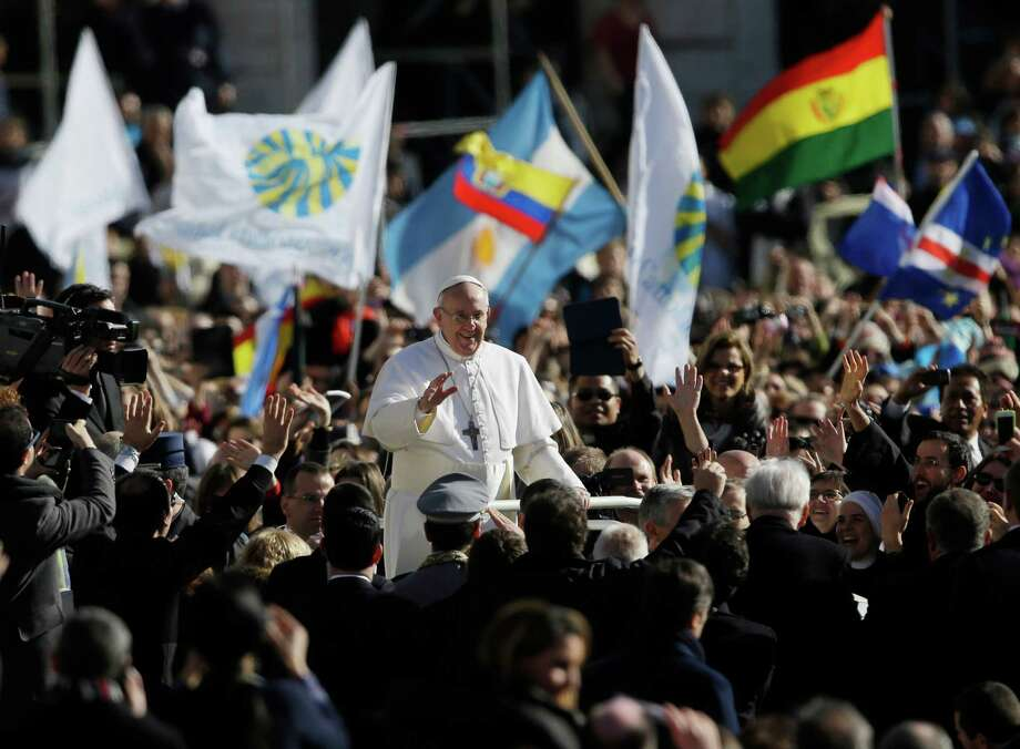 Pope Francis waves to crowds as he arrives to his inauguration Mass in St. Peter's Square at the Vatican, Tuesday, March 19, 2013. Photo: Gregorio Borgia