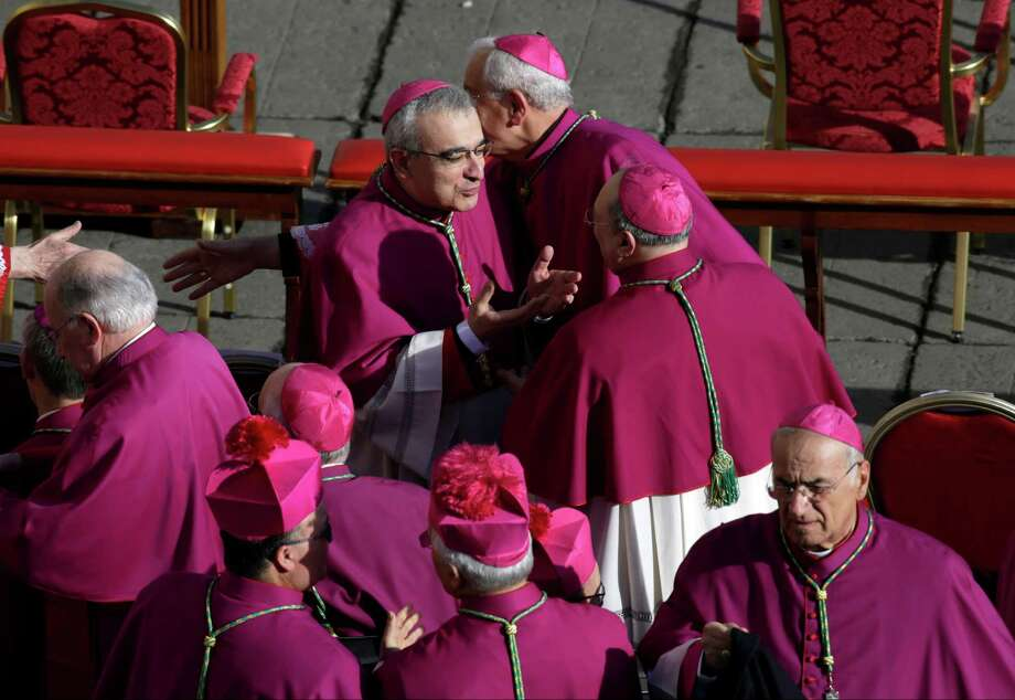 Bishops arrive to take their seats in St. Peter's Square for the inaugural Mass of Pope Francis, at the Vatican, Tuesday, March 19, 2013. Photo: Andrew Medichini