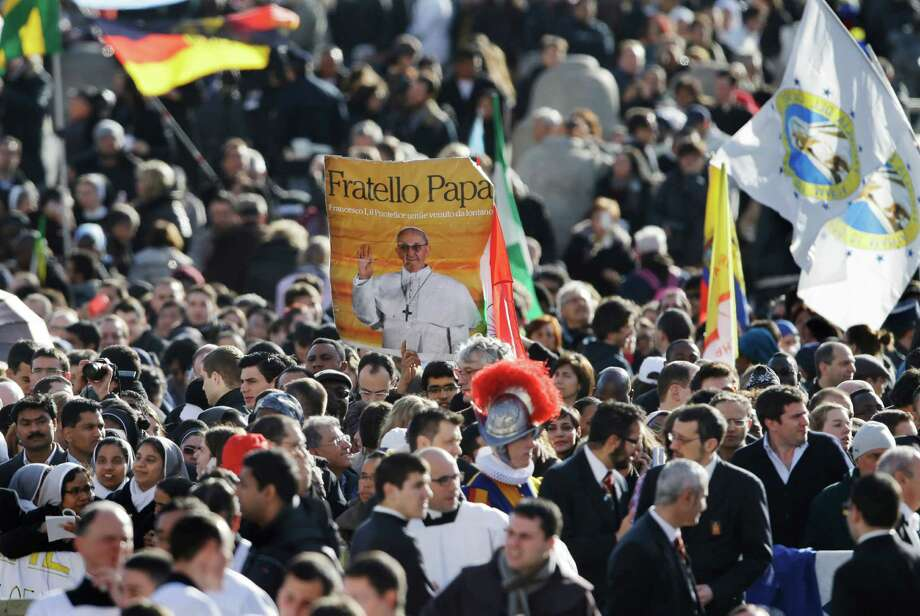 Crowds gather in St. Peter's Square for the inauguration of Pope Francis at the Vatican, Tuesday, March 19, 2013. Photo: Gregorio Borgia