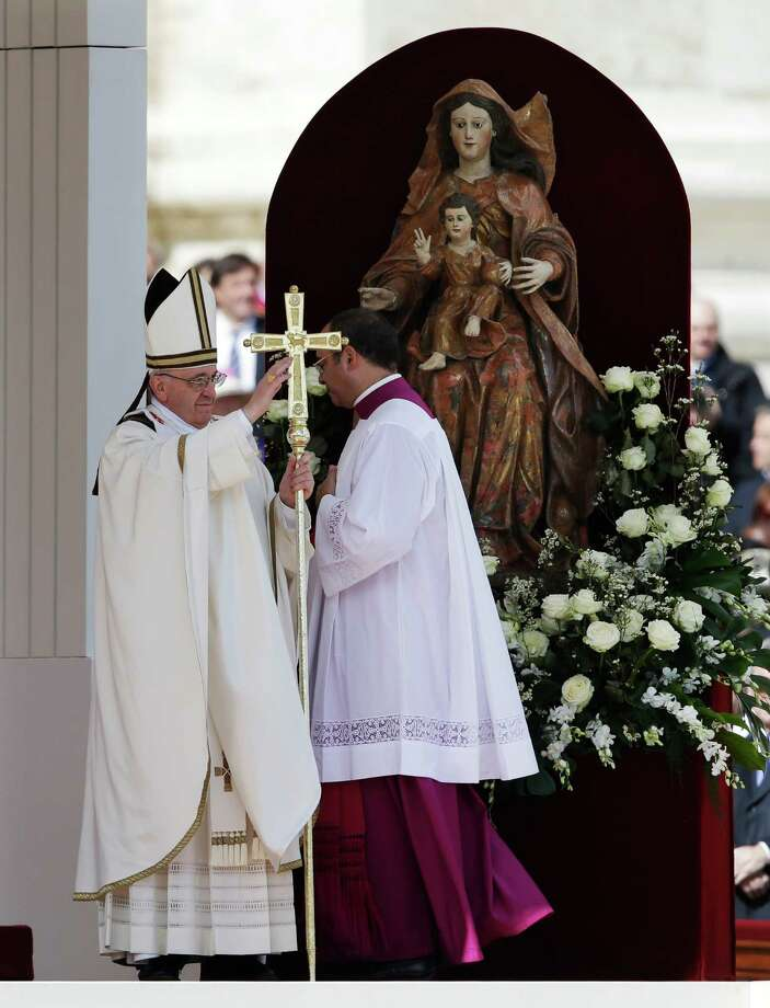 Pope Francis blesses the faithful in St. Peter's Square during his inauguration Mass at the Vatican, Tuesday, March 19, 2013. Photo: Gregorio Borgia