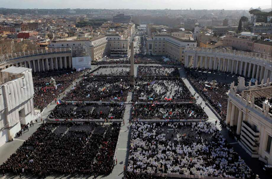 Faithful gather in St. Peter's Square at the Vatican, Tuesday, March 19, 2013. Pope Francis has urged princes, presidents, sheikhs and thousands of ordinary people gathered for his installation Mass to protect God's creation, the weakest and the poorest of the world. Photo: Dmitry Lovetsky