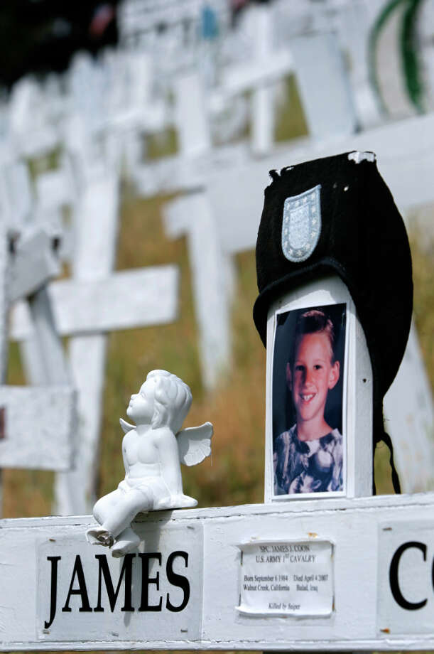 Mementos are affixed to a memorial cross on a hillside in Lafayette, Calif. on Friday, March 15, 2013. Photo: Paul Chinn, The Chronicle / ONLINE_YES