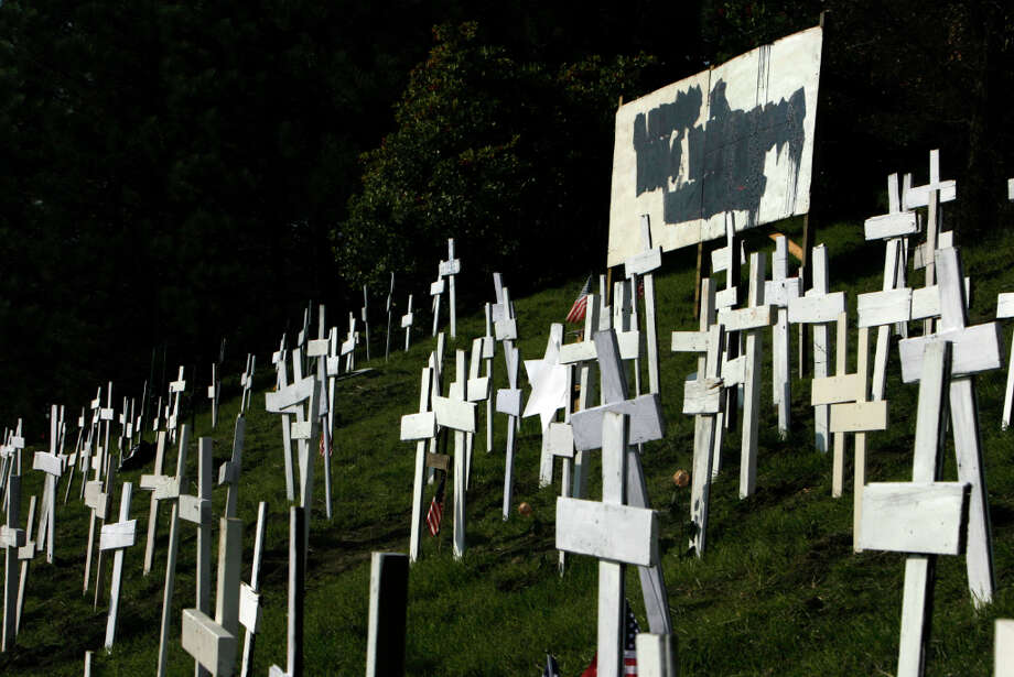 Someone vandalized the sign in 2006 in the center of the then-controversial crosses memorial in Lafayette overnight, police said, dumping black tar on a sign that read, In Memory of 2,867 Troops Killed in Iraq. Photo: JAKUB MOSUR, SFC / The Chronicle