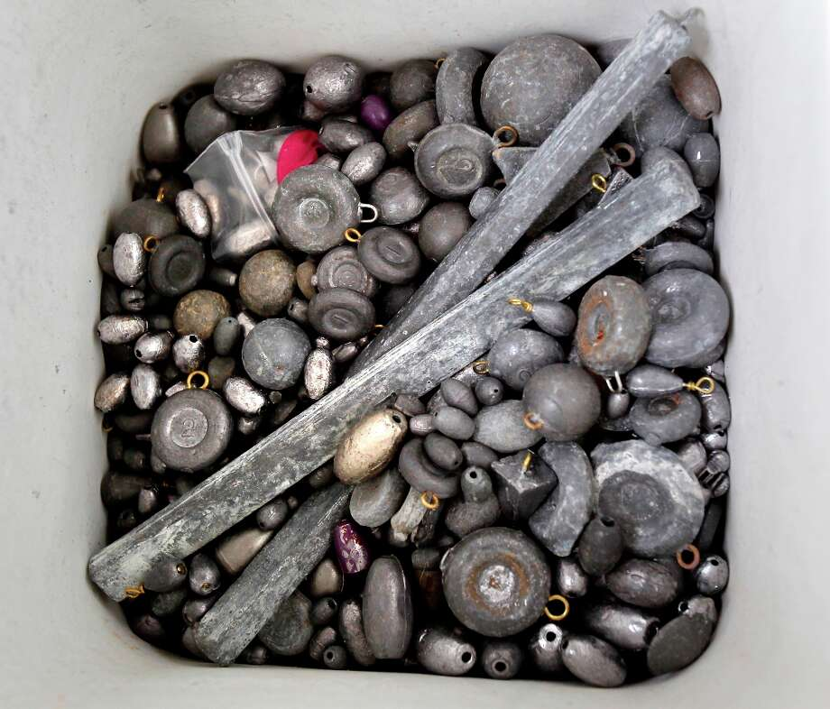 Old lead weights are collected at the main entrance to Quarry Lakes in Fremont, Calif. Monday March 18, 2013. Photo: Brant Ward, The Chronicle / ONLINE_YES