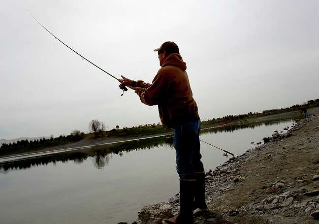 David Agrillo of San Jose casts into Horseshoe Lake Monday March 18, 2013. The Alameda County Water District and the East Bay Regional Park District are asking fishermen to trade in their old lead weights for steel and ceramic tackle because lead leaches into the water at fishing spots like Quarry Lakes in Fremont, Calif. Photo: Brant Ward, The Chronicle / ONLINE_YES