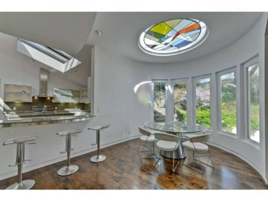 Small eating nook off the kitchen with stained glass skylight.