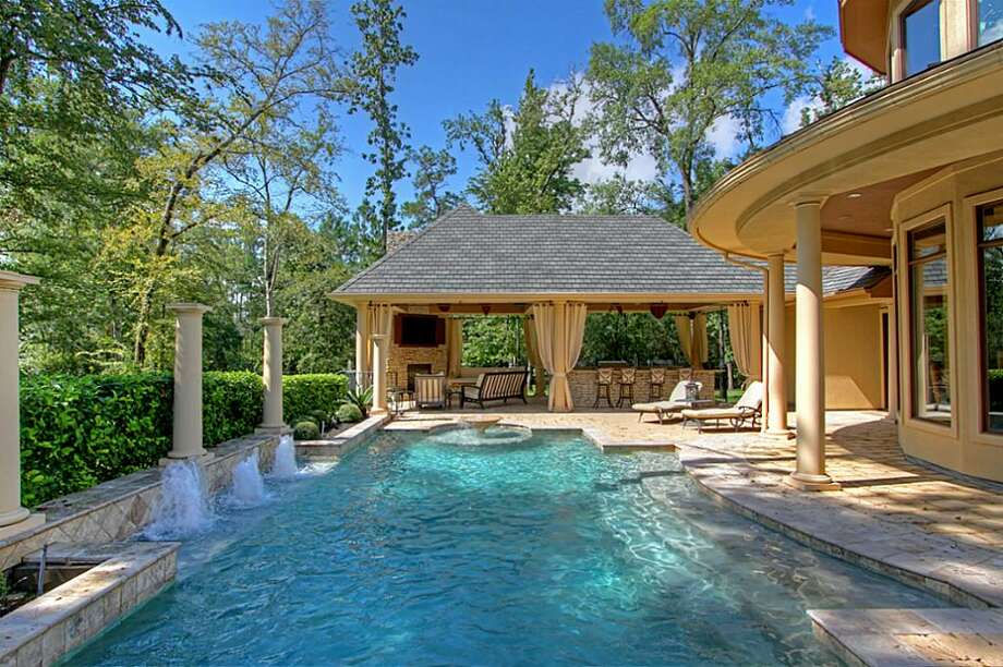 The outdoor area includes a pool. Photo: Keller Williams Realty The Woodlands