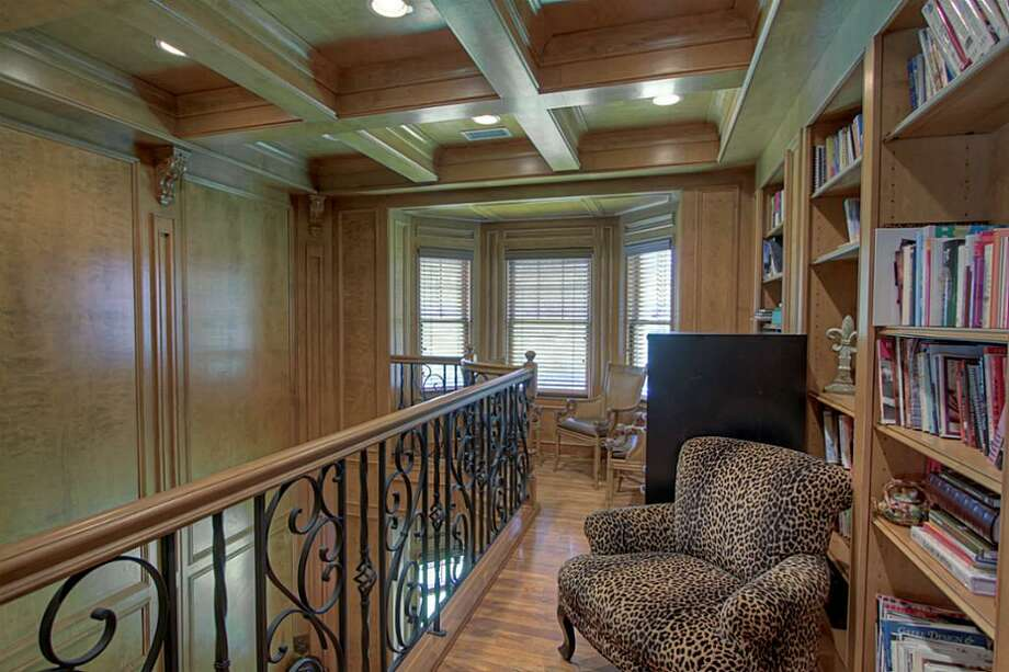 The library is located above the executive study. Photo: Keller Williams Realty The Woodlands