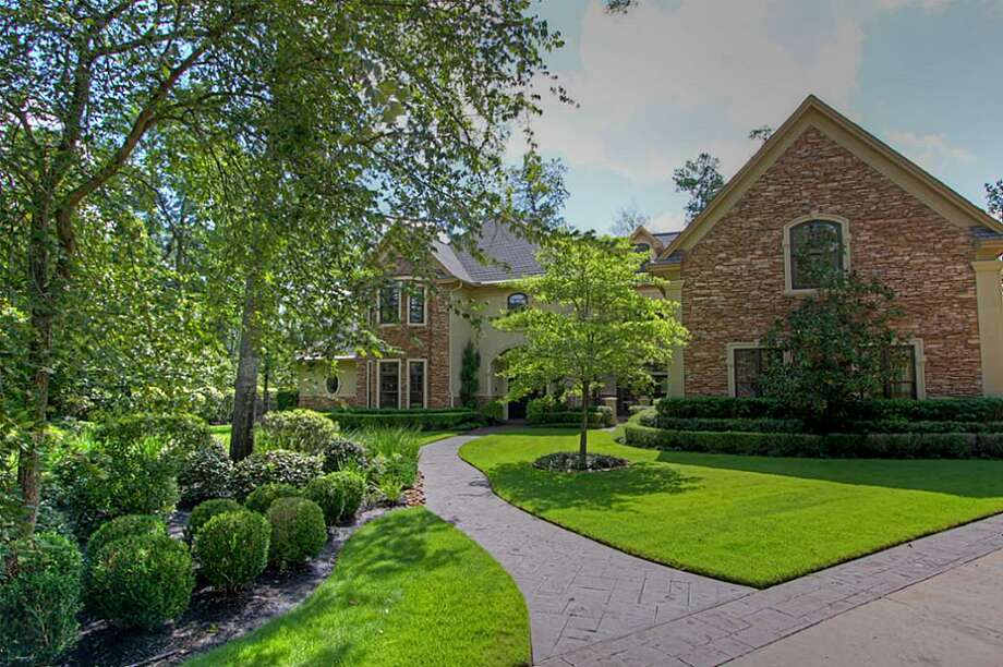 The house is an outstanding Lions Group custom home with stacked stone elevation and French-inspired design. Photo: Keller Williams Realty The Woodlands