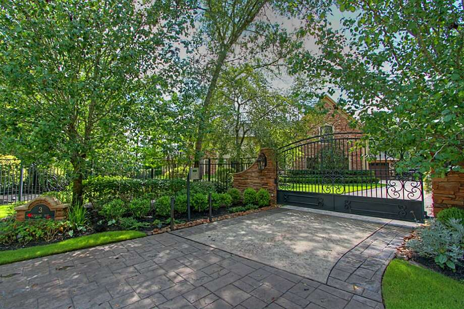 The home is fully fenced with a new electric-wrought iron gate and an intercom key pad. Photo: Keller Williams Realty The Woodlands