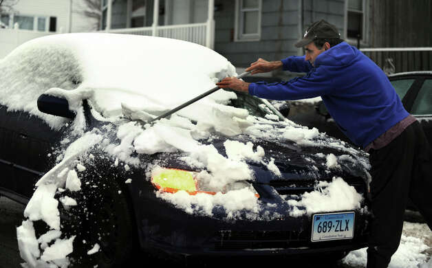 A man named Paul clears snow from his car on Griffing Ave. in Danbury, Conn., Tuesday morning, March 19, 2013, after an overnight snowfall. Photo: Carol Kaliff / The News-Times