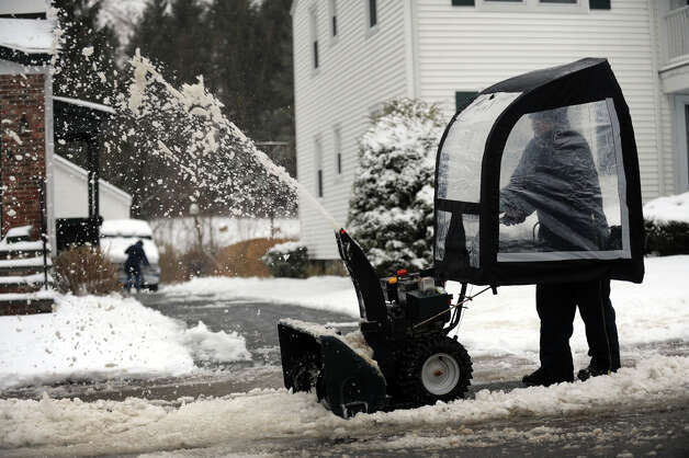Charles Reale uses a snowblower to clear snow from the sidewalk on Roger Ave. in Danbury, Conn., Tuesday morning, March 19, 2013, after an overnight snow fall. Photo: Carol Kaliff / The News-Times