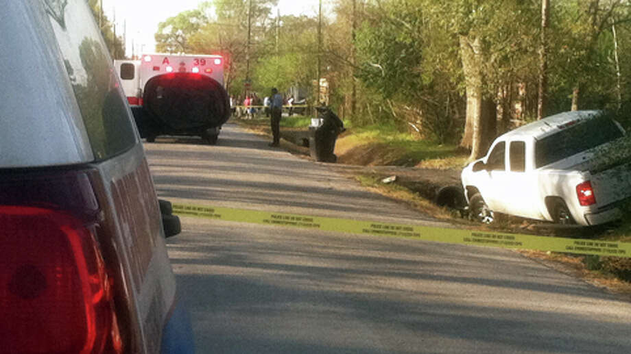 A body was discovered in a ditch about 7:20 a.m. Tuesday on Peachtree near Weaver, according to the Houston Police Department. A white pickup was in another ditch across the street. Photo: .