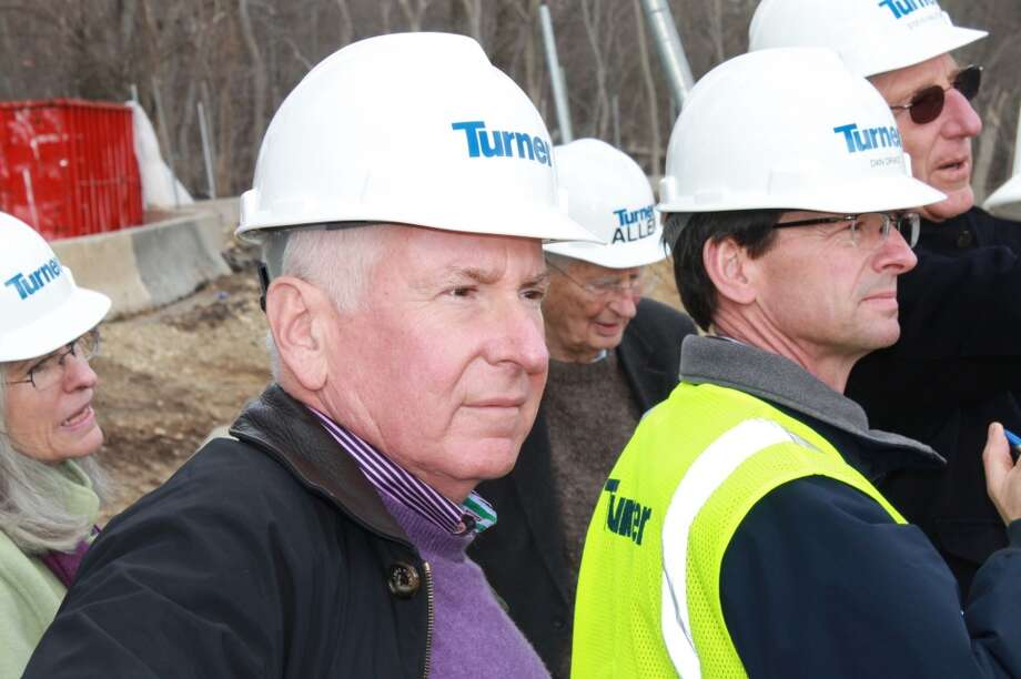 Jim Marpe, Chair of the Y Board of Trustees, looks on at the progress being made at Mahackeno