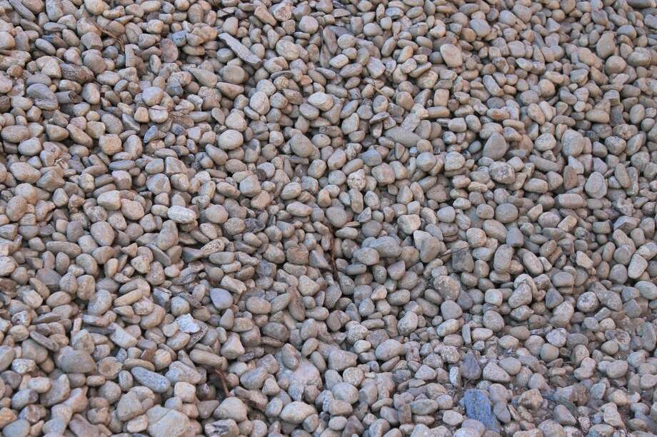Construction-grade gravel produced by the rock crushers onsite