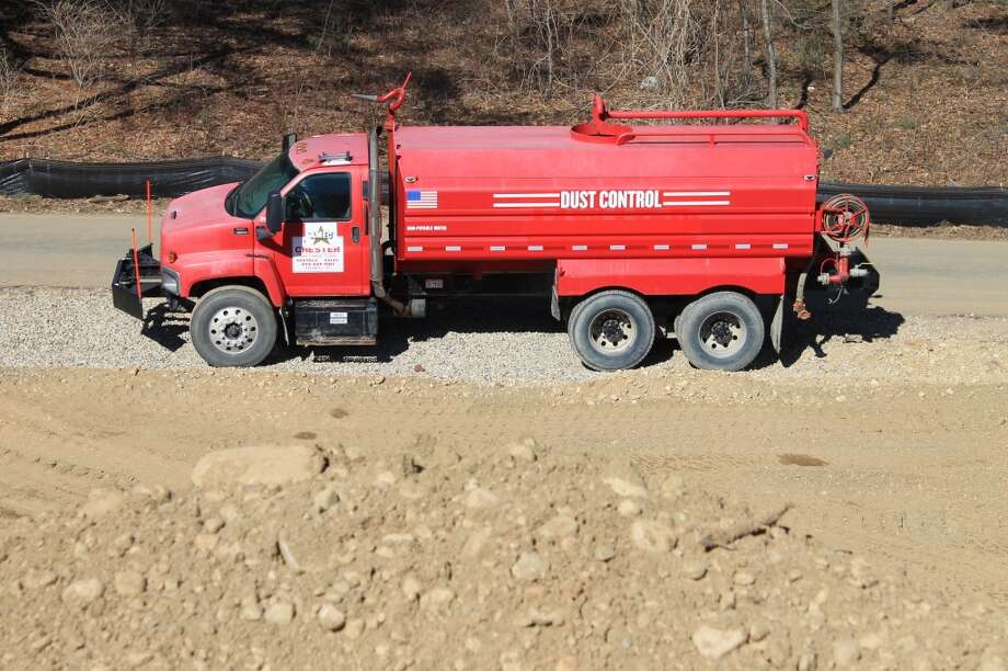 The dust control truck is kept at the ready