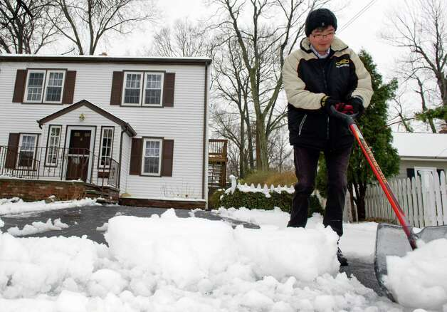 Hueichi Wen shovels his driveway in Stamford on Tuesday, March 19, 2013. Photo: Lindsay Perry / Stamford Advocate