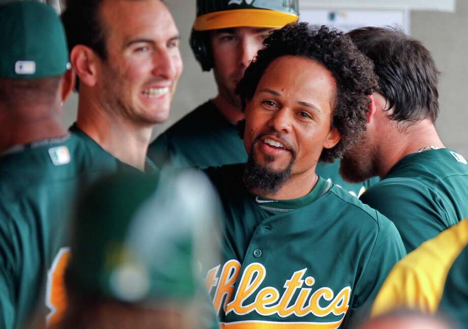 Athletic's Coco crisp, (4) returns to the dugout after scoring a run in the first inning on a ground out single by teammate Josh Reddick, (16) as the Oakland Athletics went on to beat the WBC team Italy 4-3 at Phoenix Municipal Stadium during spring training action on Tuesday Mar. 5, 2013, in Phoenix, Az. Photo: Michael Macor, The Chronicle / ONLINE_YES