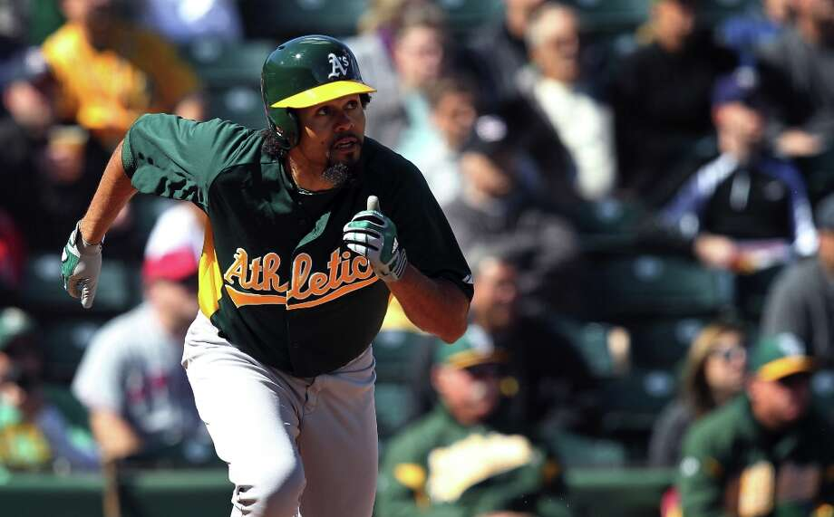 Oakland Athletics Coco Crisp watches his base hit ball during their spring training exhibition with the Los Angeles Angels in the first inning Sunday, Feb. 24, 2013, in Tempe, Ariz. Photo: Lance Iversen, The Chronicle / ONLINE_YES