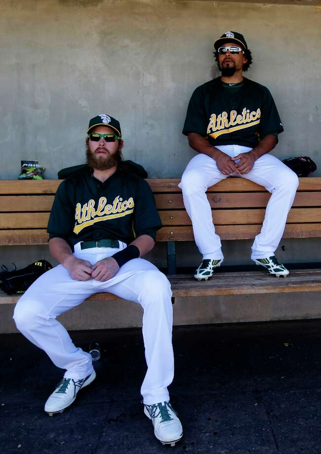 Oakland Athletics right fielder Josh Reddick and center fielder Coco Crisp before an exhibition spring training baseball game against the Colorado Rockies on Saturday, March 2, 2013 in Phoenix. Photo: Marcio Jose Sanchez, Associated Press / AP