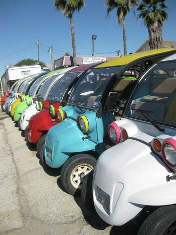 Colorful golf carts have taken over as the premier way to travel the island in style. They also help keep sand out of your vehicle. Photo: CHUCK BLOUNT, San Antonio Express-News / © San Antonio Express-News