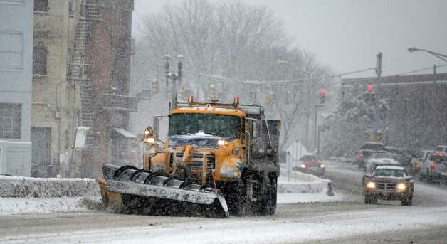 A NYS DOT plow tries to keep up with the heavy snow on Erie Boulevard March 19, 2013,  in Schenectady, N.Y.(Skip Dickstein/Times Union) Photo: SKIP DICKSTEIN
