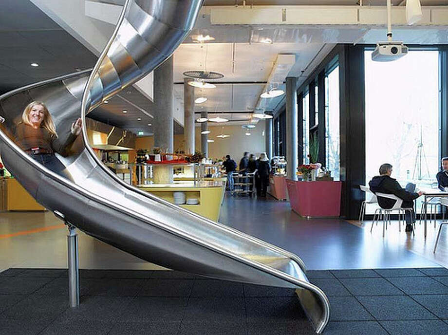 Google keeps some fun in mind at one of their offices as employees can literally slide from one floor down to the next. Photo: andrewarchy, Flickr