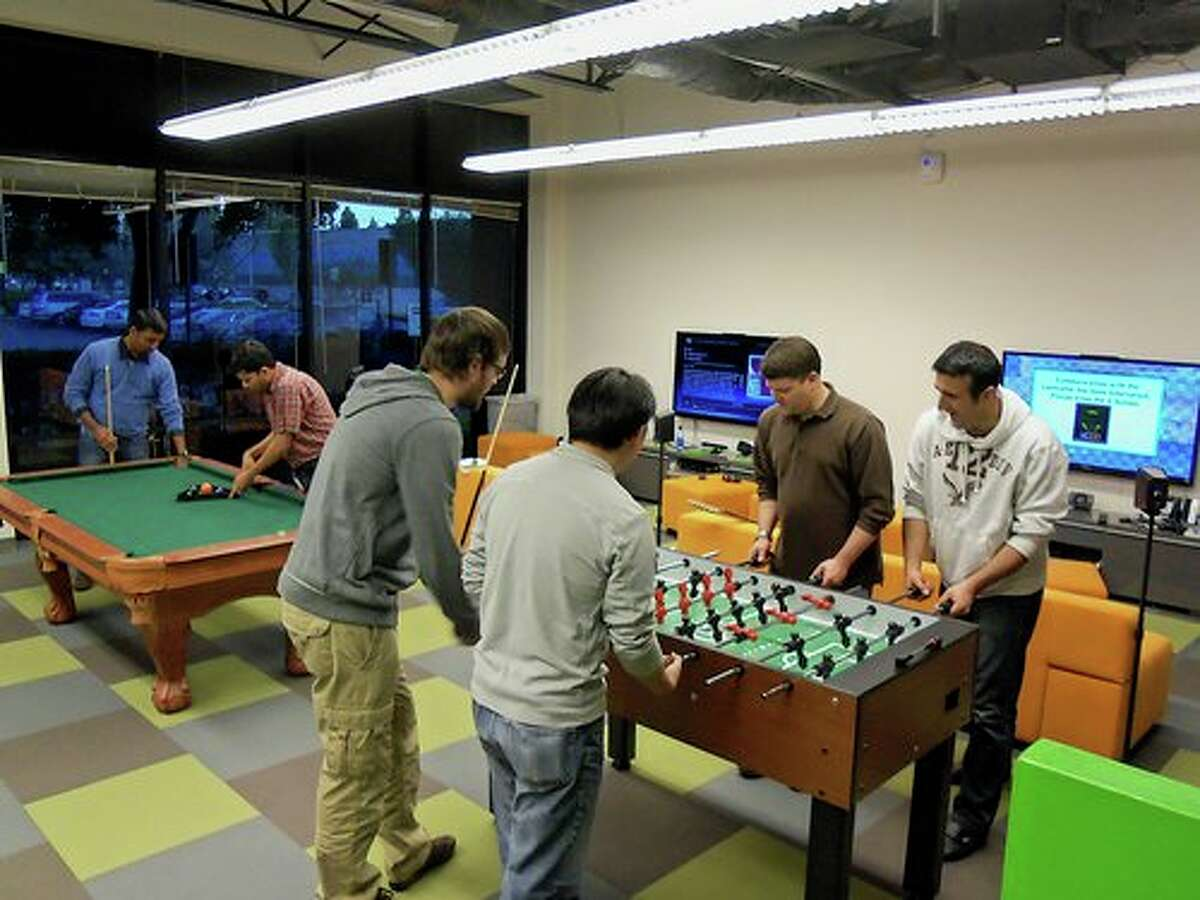 Groupon breaks away from traditional office norms by adding color and modern design to their office. Source: Glassdoor.com