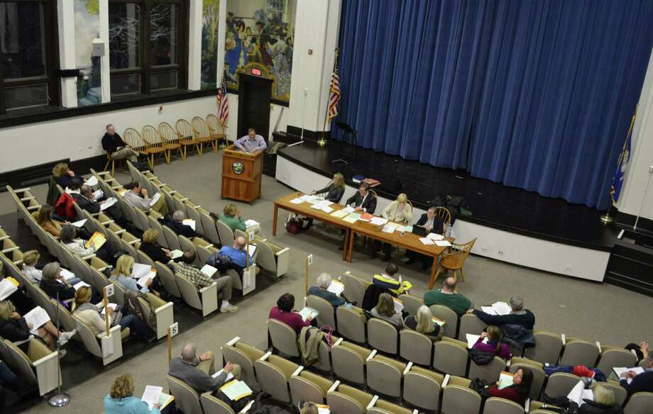 Jack Davis (at the podium), of the Finance and Budget Representative Town Meeting committee, spoke about the resolutions that went before the RTM on Monday, March 18 in Darien Town Hall. Photo: Megan Spicer