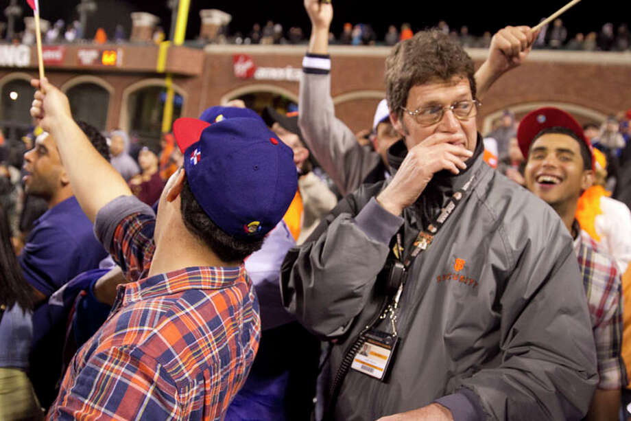 A stadium security official figures out how to clear dancing Dominican fans out of an aisle during the WBC semi-final game between the Dominican Republic and Netherlands at AT&T Park in San Francisco on March 18, 2013. Photo: SF Gate / Douglas Zimmerman