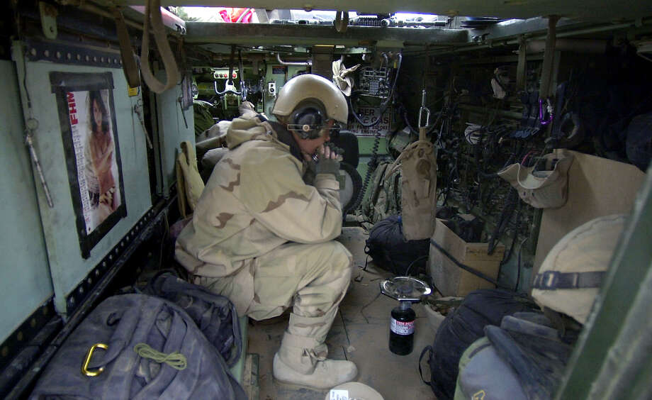 A1C Nick Taylor (OH) sits alone in the back of an M113-A3 armored carrier during a break in action in South Cental Iraq on March 24, 2003. Photo: BAHRAM MARK SOBHANI, SAN ANTONIO EXPRESS NEWS / SAN ANTONIO EXPRESS NEWS