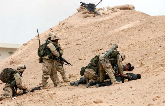 U.S. forces take three enemy POWs after a battle near Ah Najaf as 3rd Infantry troops moved north through the central farmlands of Iraq on March 23, 2003.  Photo: BAHRAM MARK SOBHANI, SAN ANTONIO EXPRESS NEWS / SAN ANTONIO EXPRESS NEWS