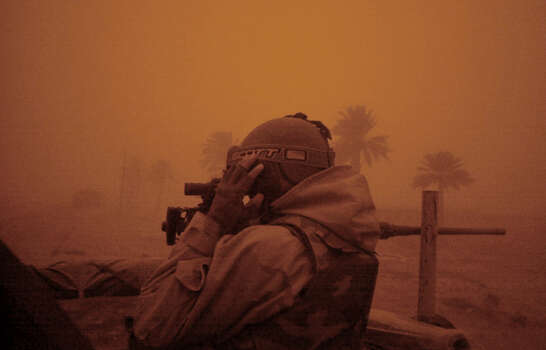 Air Force SSgt. Travis Crosby (GA) adjusts his night vision goggles as a sandstorm creates a brownout effect in Southern Iraq on March 25, 2003. Heavy clouds of dust and sand reduced visibility and brought the dark a few hours early. Photo: BAHRAM MARK SOBHANI, SAN ANTONIO EXPRESS NEWS / SAN ANTONIO EXPRESS NEWS