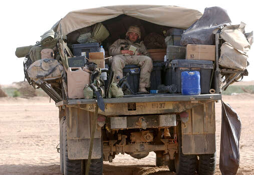 Sgt. Andrew Barnett (GA) with the Army 27 Infantry of 1st Brigade reads the Bible in the back of his truck on March 29, 2003, in the South Central Iraqi desert.  Photo: BAHRAM MARK SOBHANI, SAN ANTONIO EXPRESS NEWS / SAN ANTONIO EXPRESS NEWS